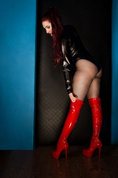 fishnets and thigh high stiletto boots