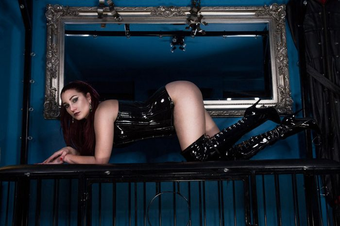 professional domme wearing thigh high boots in London